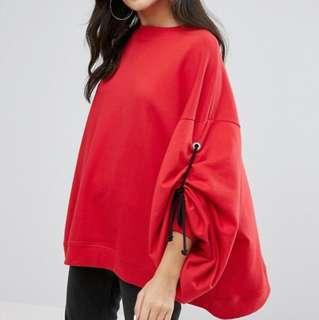 Oversized red sweater with rope tie