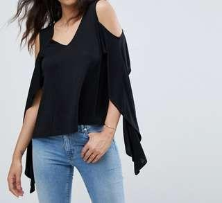 Black top with cold shoulder and ruffle