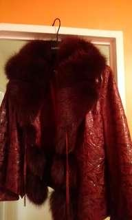 Reel leather and fur coat. Brand new. Made in Argentina.