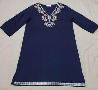 Blue dress with embroidered details