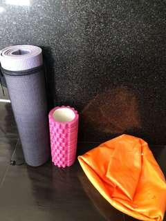 Yoga mat, foam roller and yoga ball