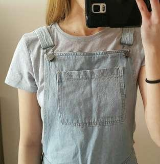 Light-washed, distressed overalls