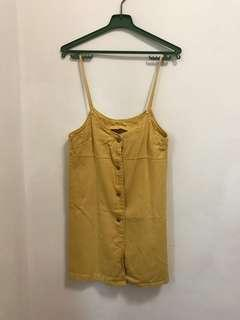 Dungaree dress in yellow