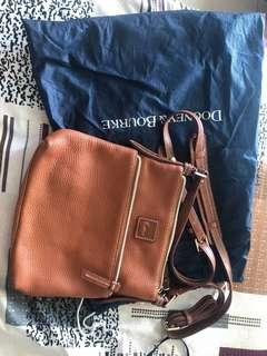 Authentic Dooney and Bourke Sling Bag.  (Used only once)