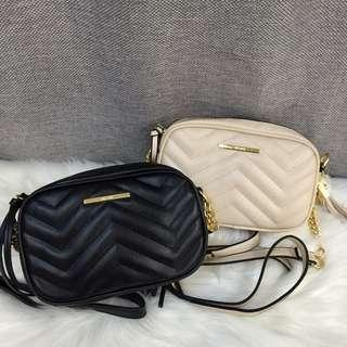 ALDO QUILTED ROUND CROSS BODY CHAIN BAG