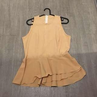 Peplum cream top