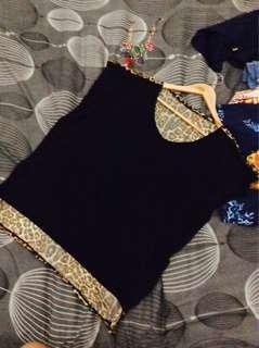 Black top with leopard design