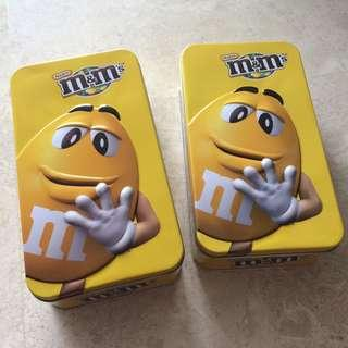 2 yellow m&m's containers