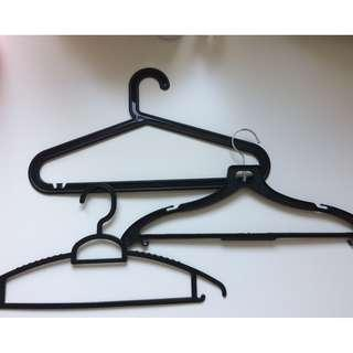 38 black hangers in 3 different shapes