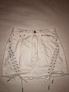 really cool white denim skirt w tie detailing