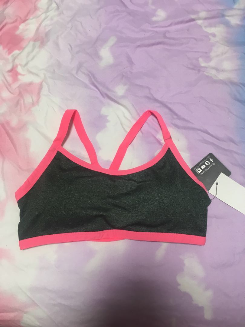 f15867fa64973 cotton on neon pink and grey spider web criss cross sports bra ...