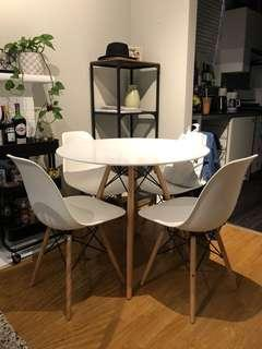 Round white table with four chairs dining set