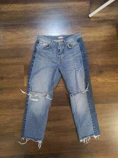 Side striped knee ripped jeans