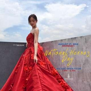 Red ball gown with trail for rent