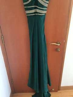 Beautiful emerald green gown with stone work