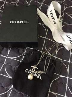 Chanel pearl necklace with camelia