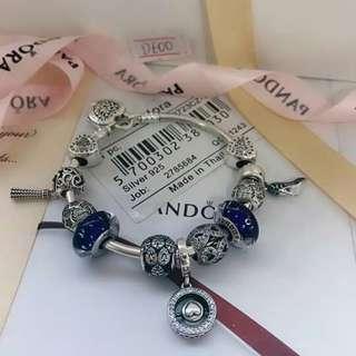 Pandora silver bangle with charms