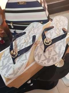 MK slippers