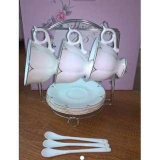 Porcelain Cups & Saucer 6 pcs set,  comes with spoons and a cup holder.