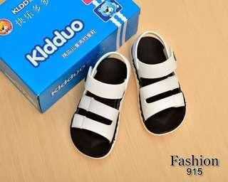 Sandal Anak Kidduo 915## Semi Premium Bahan : Kulit (WITH BOX) Warna : Black, White Berat : 0,3kg  Insole :  26 - 18cm 27 - 18,5cm 28 - 19cm 29 - 19,5cm 30 - 20cm  Rp 175.000