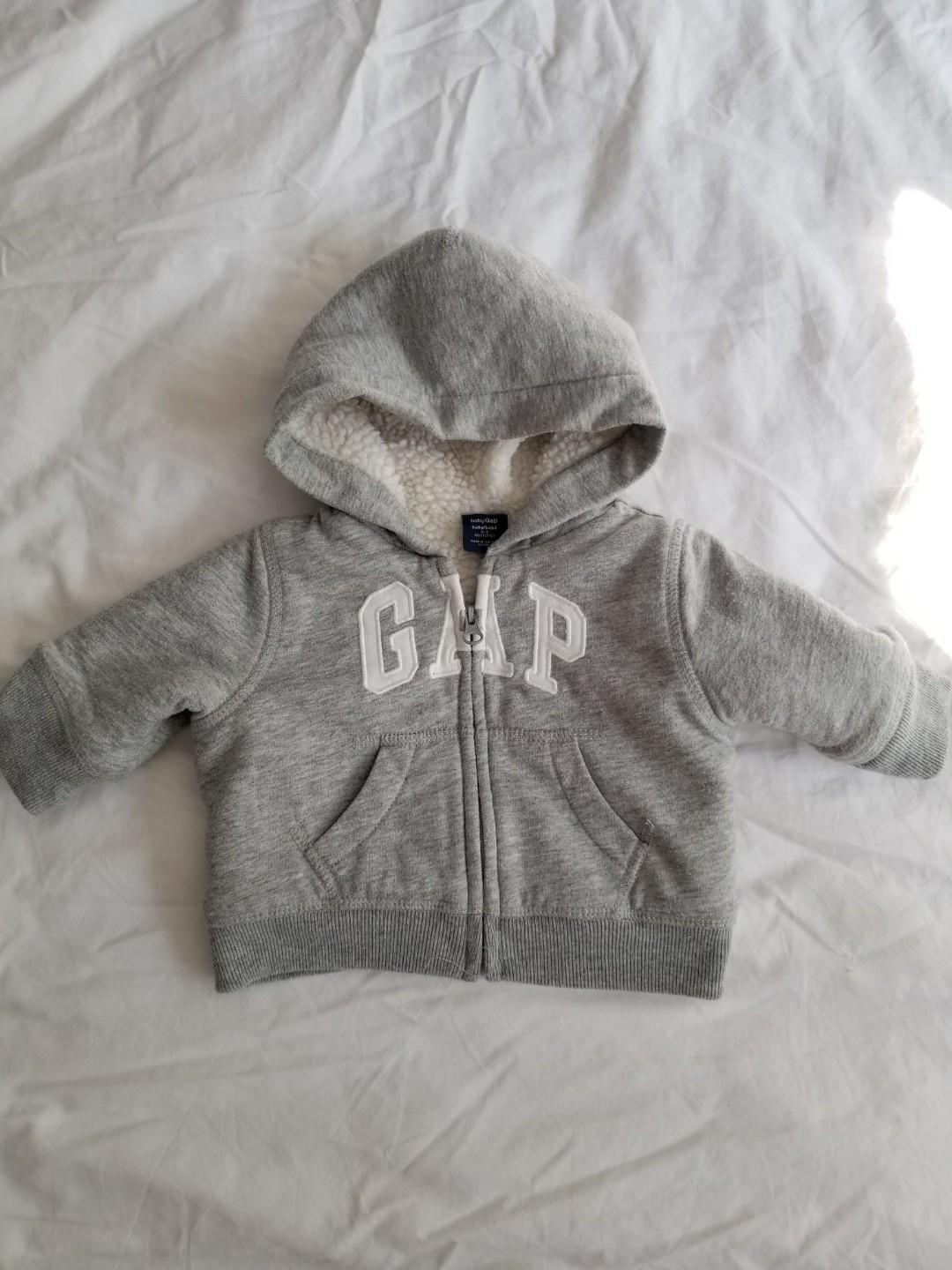 Baby Gap hoodie. Must have for fall winter. New condition. Size 0-3 mths. Purchased new for $39. Porch pick up beaches at main and kingston $8 or yorkville $10.