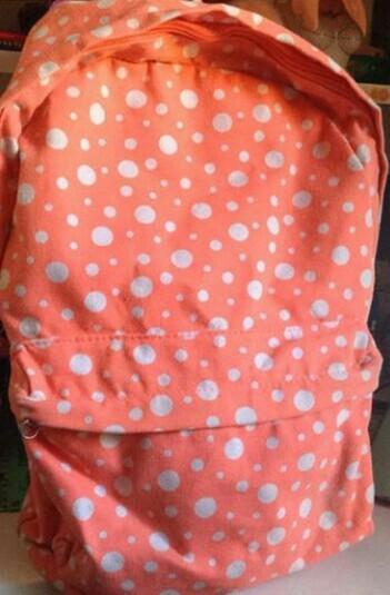 orange poka dot backpack