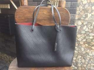 Charles & Keith reversible tote bag in black and red with extra pouch