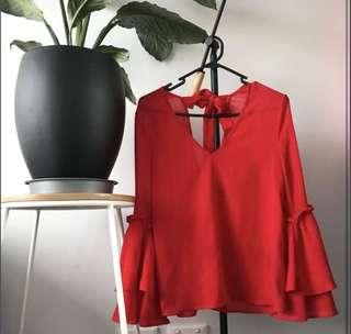 Red trumpet sleeve blouse