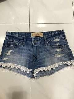 Authentic Hollister denim lace hem shorts ripped