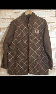 Brown knitted winter jacket