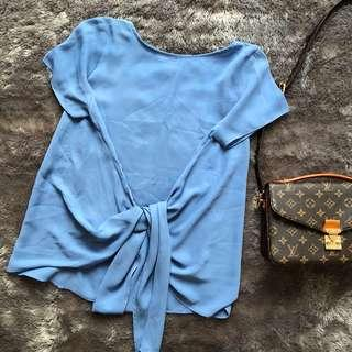 Blue tied blouse