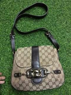 Gucci canvas sling