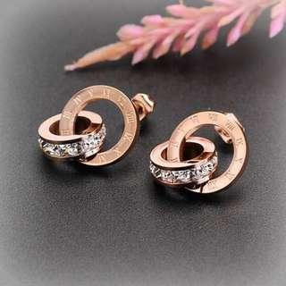 Rose Gold Tone Roman Numeral Stainless Steel And Zircon Stud Earrings