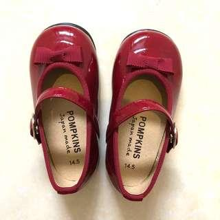 Red patent shoes with bow