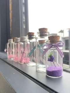 tiny glass bottle