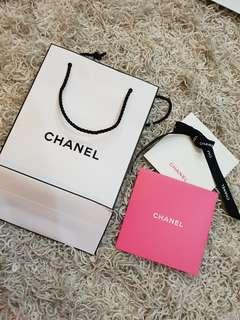 chanel paper beg with gift card and ribbon