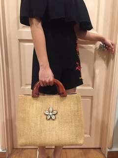 Straw bag with wooden handle