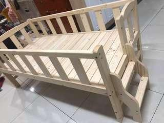 solid wood crib with protective fence