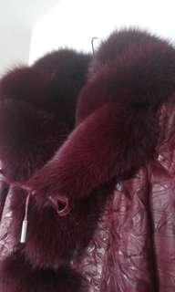 Brand new. Gorgeous real leather and fur jacket. Made in Argentina.