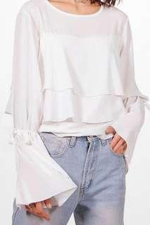 Woven top with ruffle tie sleeve (ivory)