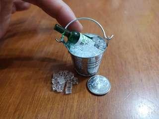 Miniature ice bucket with ice