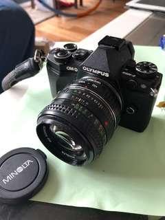 Olympus OMD EM 5 W/ MD Rokkor 50mm F/1.4 legacy lens