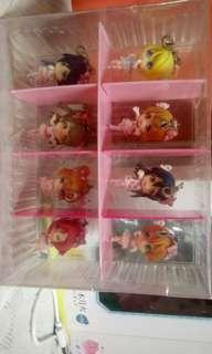 8 miniature love live figurines with casing.