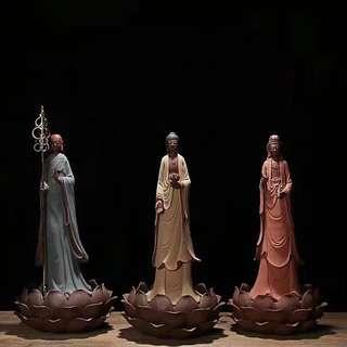 3 religious figurines