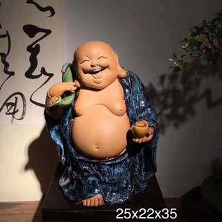 5 Different laughing Buddha statues