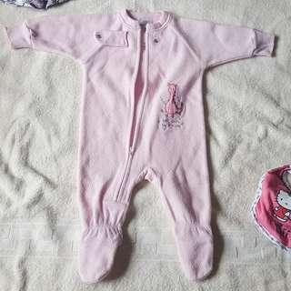 Pink fleece onesie with baby dragon design