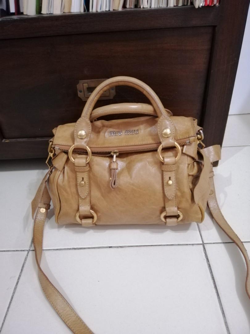 f510dc6e1282 Authentic miu miu mini small bow leather sling bag