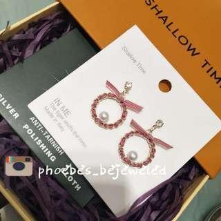 Expanda hypoallergenic dangling earrings ribbon style