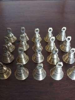 22 small brass bells