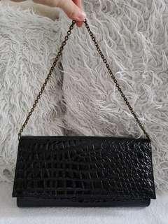 Black crocodile skin style clutch bag